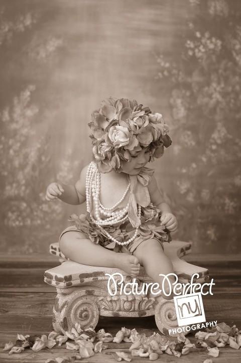 baby girl wearing pearls vintage flowers