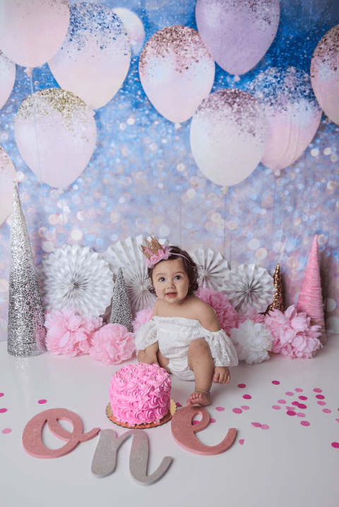 girl's glitter background first birthday.