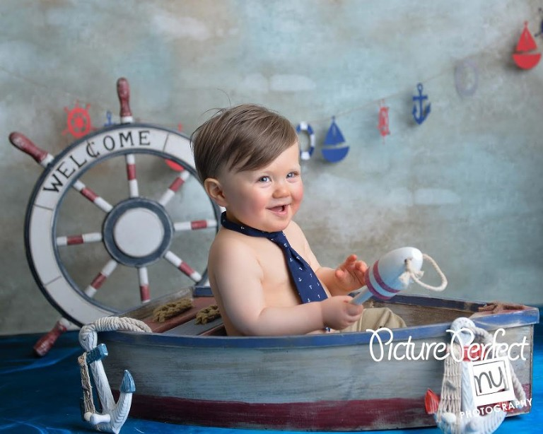 Nautical theme first Birthday boy in boat