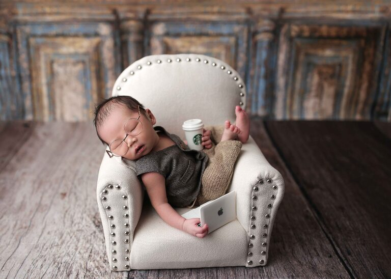 NEWBORN boy laying in chair, working on computer and coffee