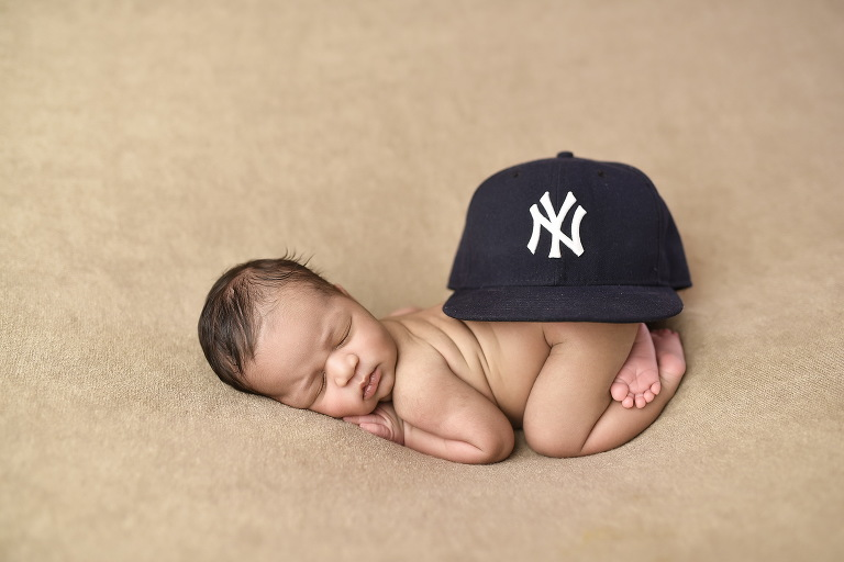 baby wearing yankee hat