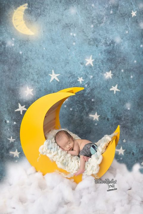 This newborn had no trouble sleeping during his session! Notice how his pose is much tighter than the babies at 4-6 weeks old.