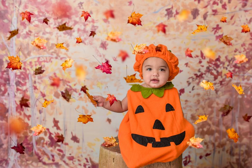 baby wearing pumkin costume