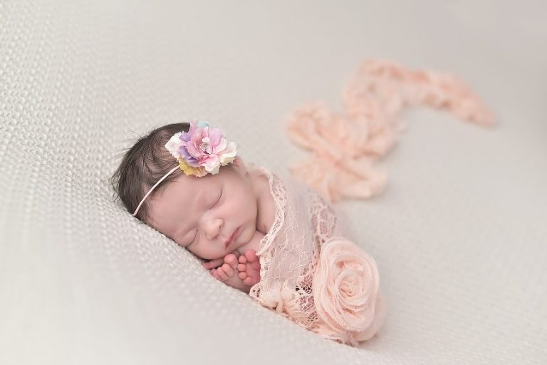 Baby Amirah sleeps soundly at her newborn session.