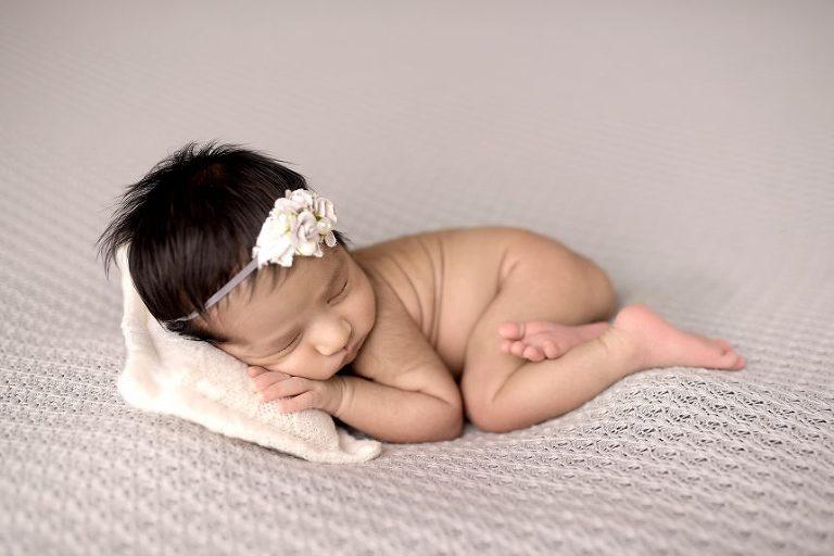 NYC Newborn sleeping on pillow