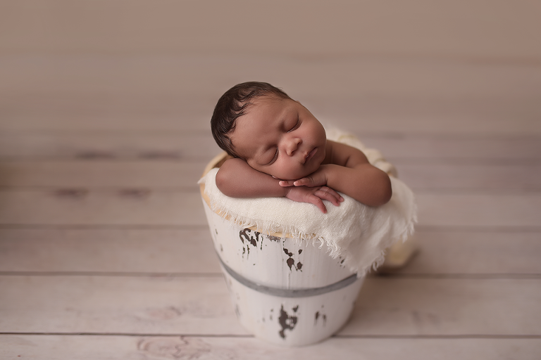 newborn baby posed in the bucket by nyc newborn photographer picture perfect ny