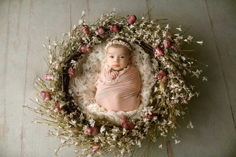 brooklyn ny newborn photos, baby girl swaddled in center of floral wreath
