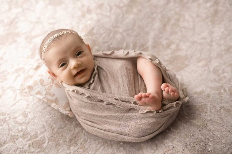 newborn baby photographer new york, smiling baby in swaddle
