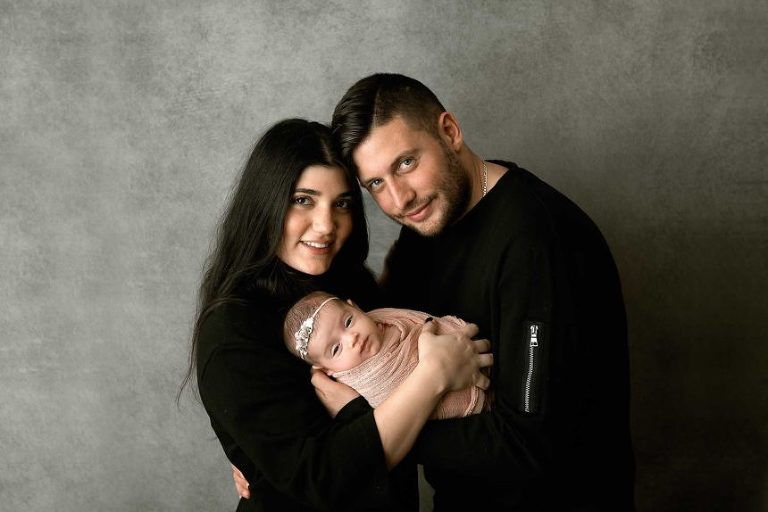 new york baby photographer, parents holding new daughter